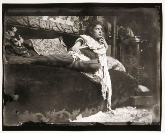 Alphonse Marie Mucha. Model reclining on the couch in Mucha's studio rue du Val de Grâce 1899 Via muchafoundation