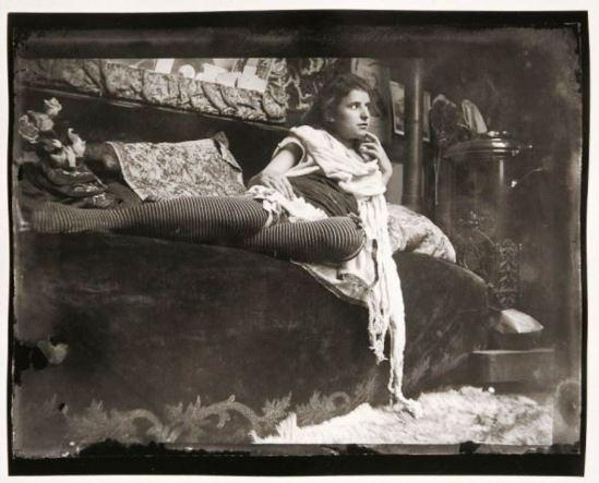 Alphonse Marie Mucha. Model reclining on the couch in Mucha's studio rue du Val de Grâce 1899 Via muchafoundation