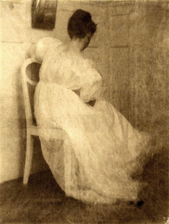 Heinrich Kühn. Miss Mary seated on a white chair 1910 Via mutualart