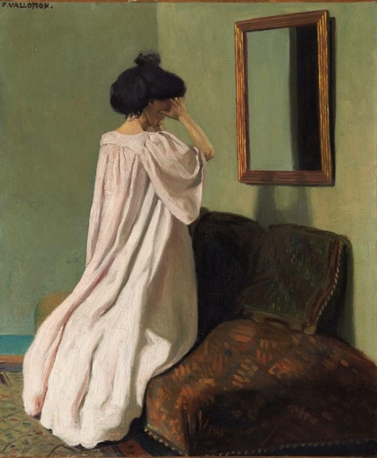 Félix Vallotton. Gabrielle Vallotton agenouillée devant une glace sur le divan de l'atelier de la rue des Belles-feuilles  1905