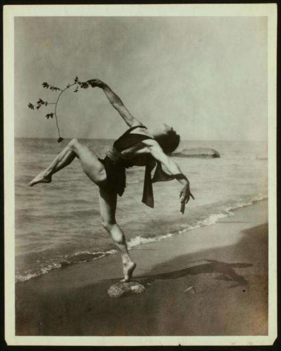 Andreas Pavley. In a Grecian dance, posed on a beach. Via nypl