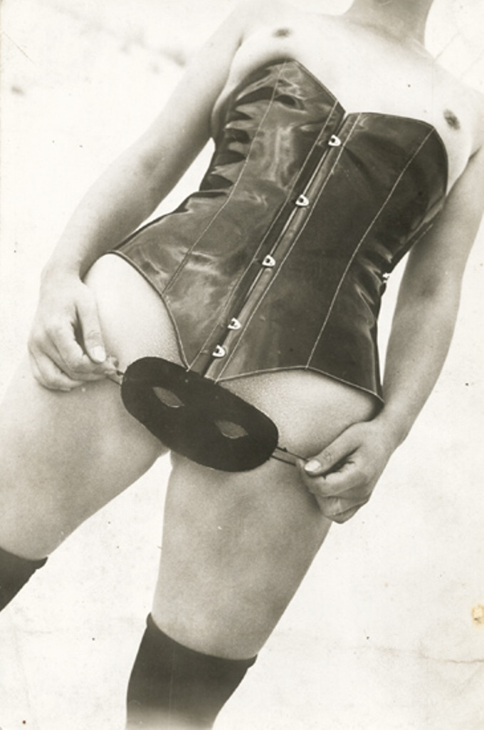 Jean Moral (attribué à).  Woman in a leather corset with mask  1930. Via iphotocentral