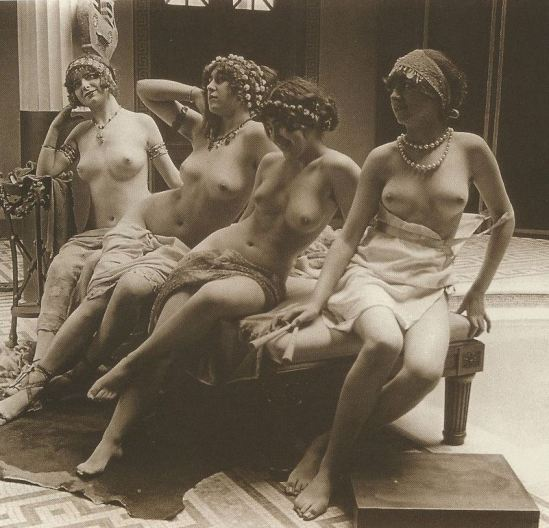 Nude burlesque girls on couch 1898. Via ebay