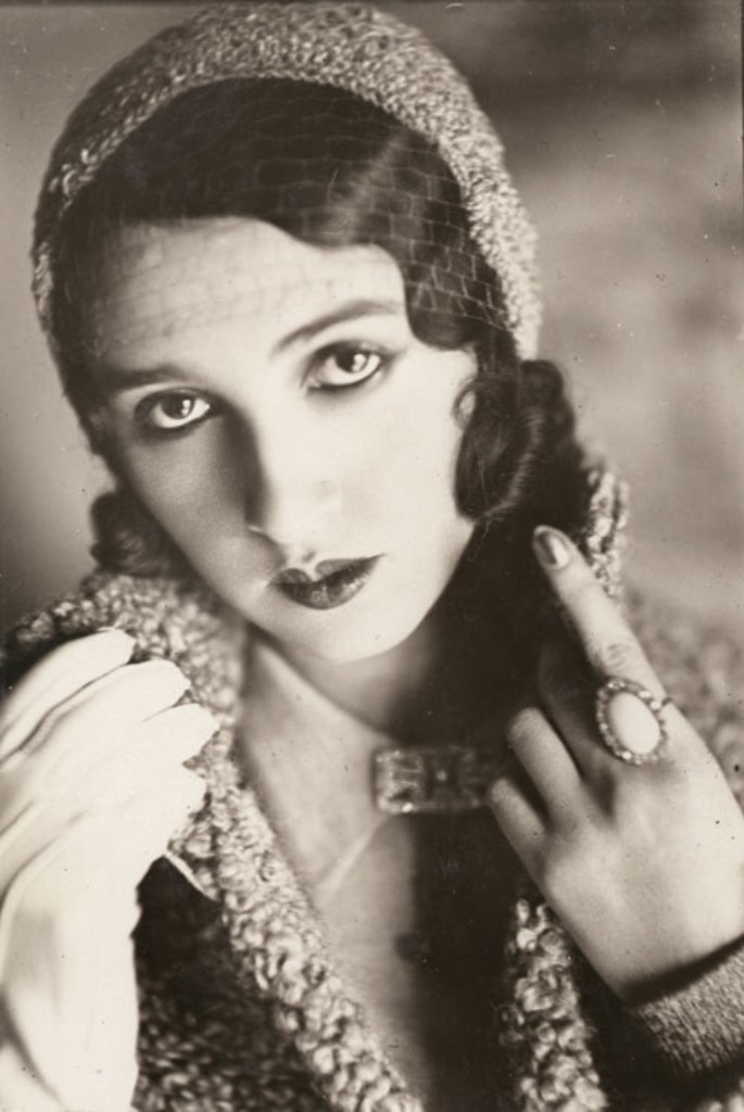 Jacques-Henri Lartigue. Renée Perle in veiled cap with one gloved hand and ring 1930. Via liveauctioneers