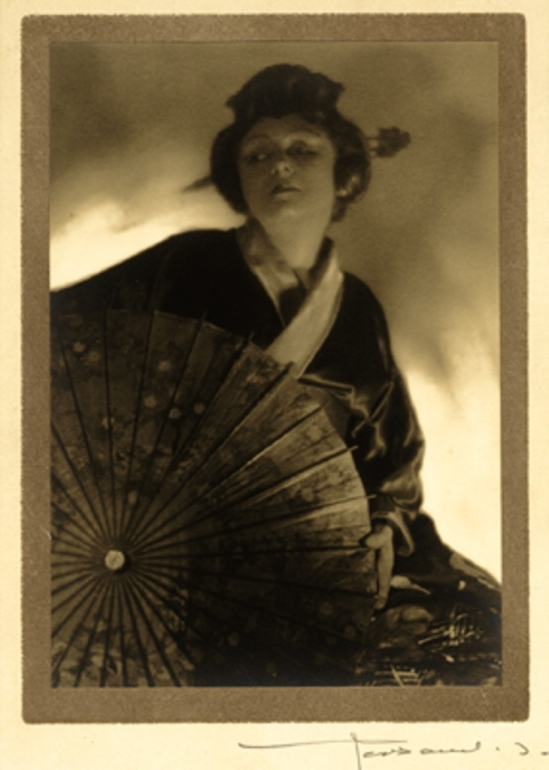Portrait of a Japanese woman. (Possibly a French woman dressed in Japanese robes). Early 20th century