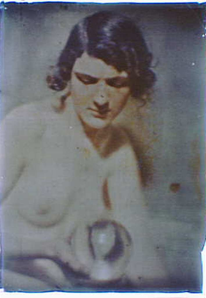 Arnold Genthe . Nude study of a woman holding a glass ball. Autochrome. Via loc.gov