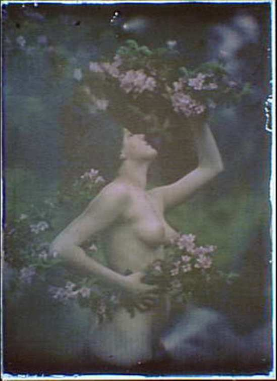 Arnold Genthe. Nude woman wearing floral garlands,wreaths 1906.Autochrome. Via ebay