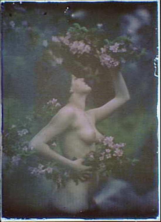 Arnold Genthe. Nude woman wearing floral garlands,wreaths 1906.Autochrome. Via ebay