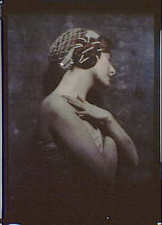 Arnold Genthe. Woman wearing pearled headpiece, arms crossed over chest. Via ebay