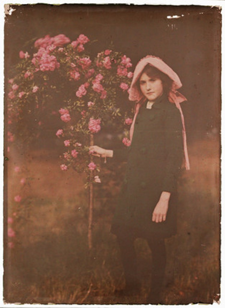 Etheldreda Janet Laing. young girl standing in a garden 1910. Autochrome ® National media museum