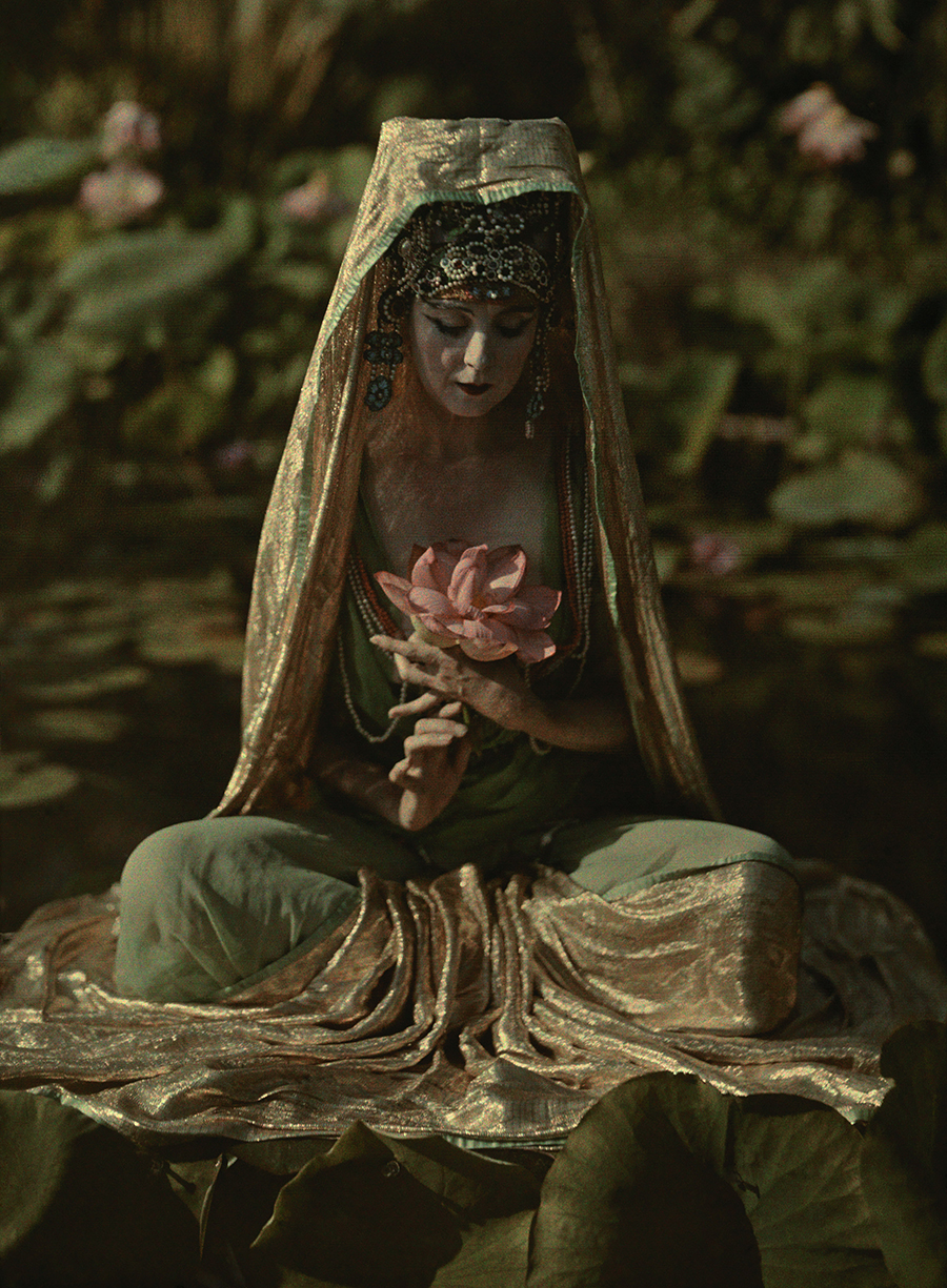 Franklin Price Knott. Woman adorned like a chinese goddess poses in a garden in California 1915. AutochromeVia National Geographic