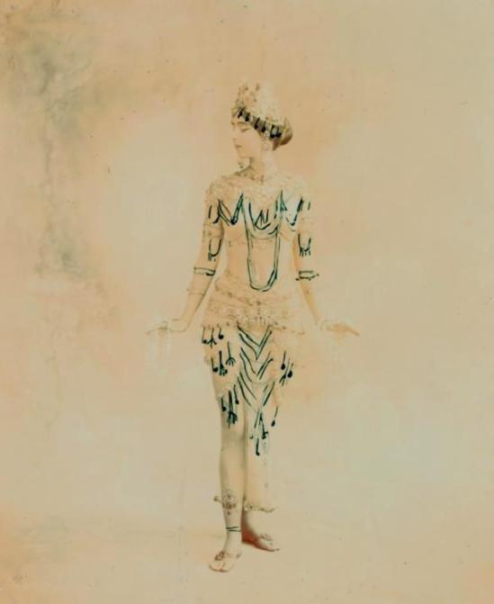 Ruth St. Denis in Radha, transitional costume with black tracings indicating added jeweled pendants. Via nypl