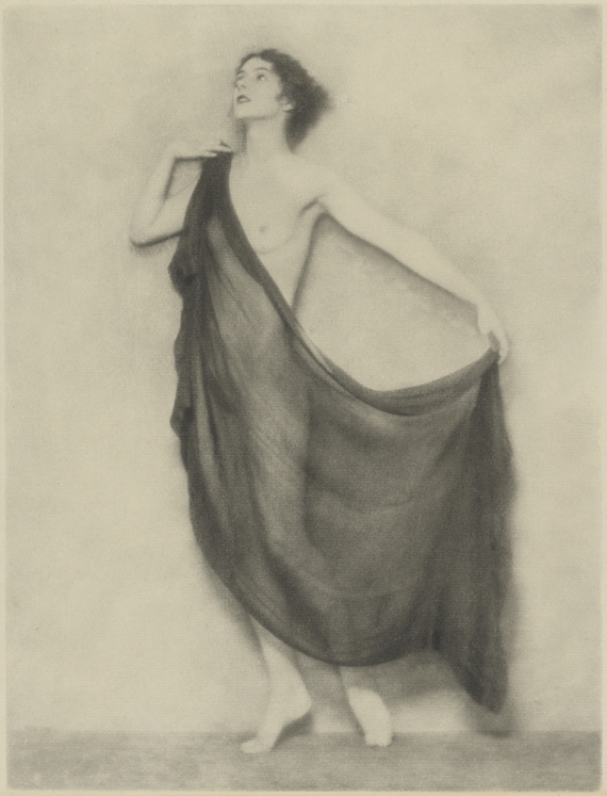 Arthur F. Kales. Draped Female Nude Standing Against a Bare Background 1920. Via getty
