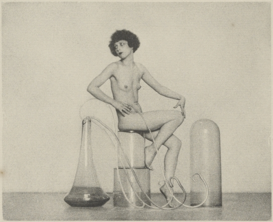 [Female Nude Posed With Glass Jars]