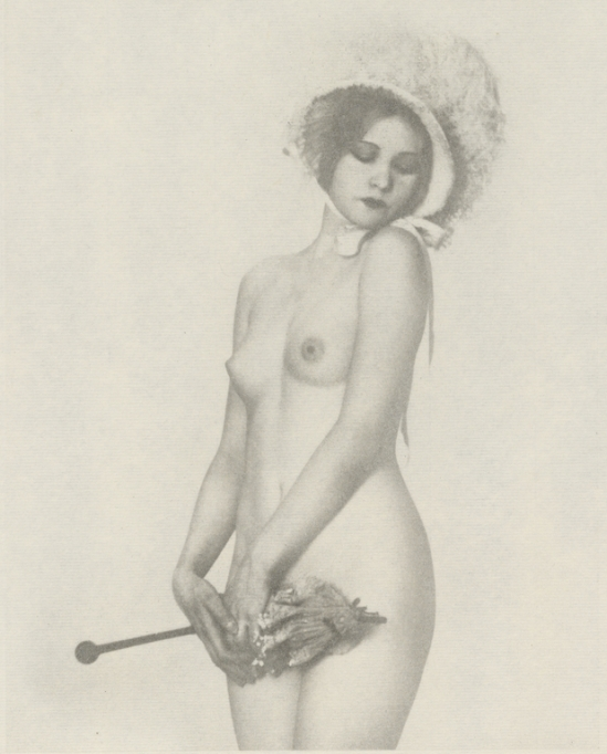 Arthur F. Kales. Female Nude Wearing Bonnet and Holding a Parasol]. Via getty
