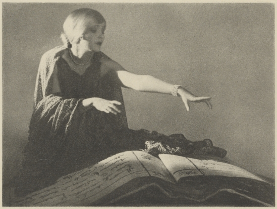 Arthur F. Kales. Woman Reaching Out Over a Large Book 1920. Via getty