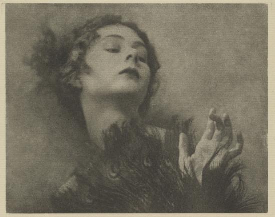 Arthur F. Kales. Woman with Peacock-Feather Fan 1920.  Via getty