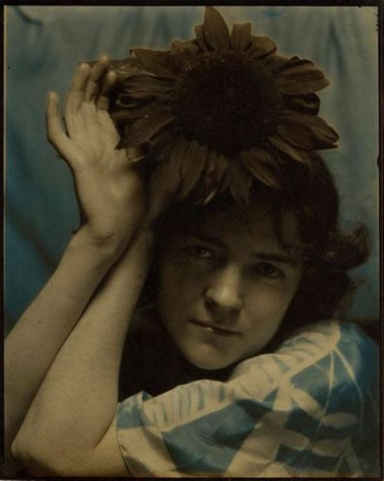 Edward Steichen. Dana Steichen Holdind sunflower to head 1920. Via eastman museum