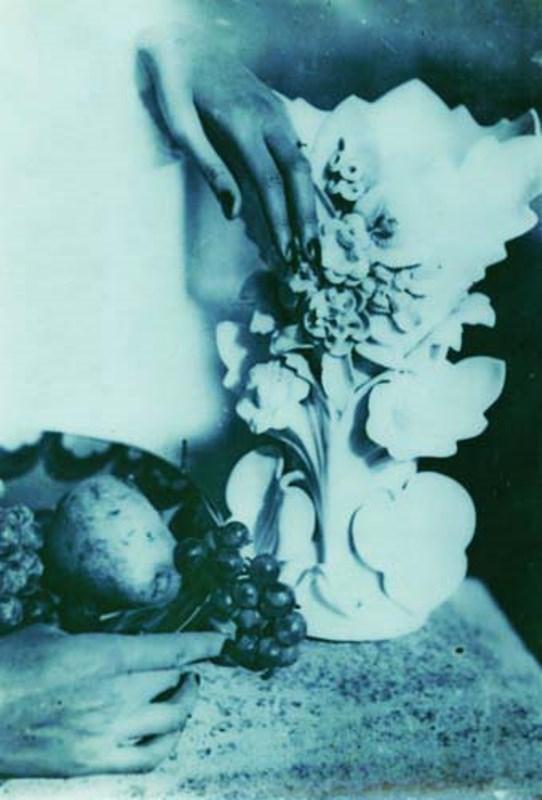 Jacques-Henri Lartigue. Still life with disembodied hands, fruit, and vase 1930. Via artnet
